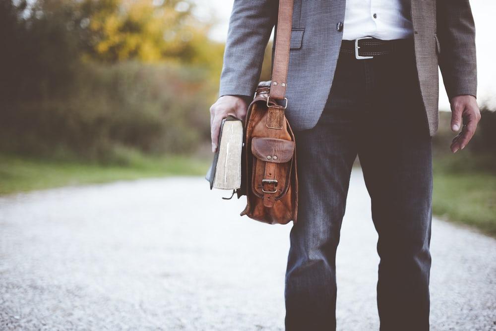 man with satchel